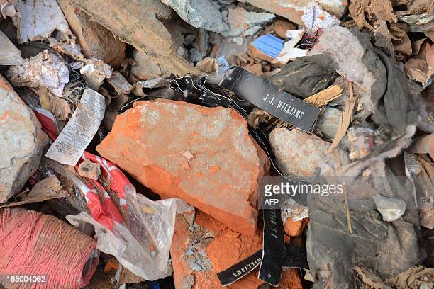 JJ Williams clothing tags are seen amongst the rubble at the site of the eightstorey building collapse in Savar on the outskirts of Dhaka on May 4...