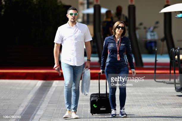 Williams Deputy Team Principal Claire Williams and husband Marc Harris walk in the Paddock during previews ahead of the Abu Dhabi Formula One Grand...