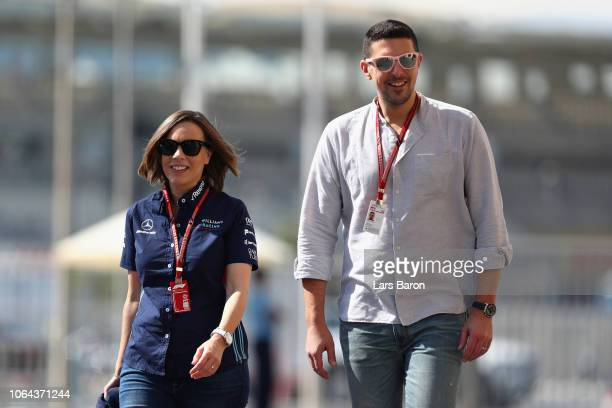 Williams Deputy Team Principal Claire Williams walks in the Paddock with husband Marc Harris before practice for the Abu Dhabi Formula One Grand Prix...