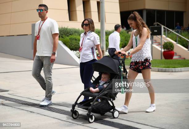 Williams Deputy Team Principal Claire Williams walks in the Paddock with husband Marc Harris during previews ahead of the Bahrain Formula One Grand...