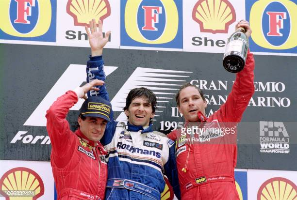 Williams driver Damon Hill of Great Britain celebrates after winning the San Marino Grand Prix with 2nd placed Jean Alesi of France & Ferrari and 3rd...