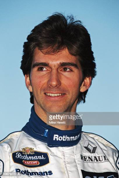 Williams driver Damon Hill of Great Britain looks on during a break in testing at the Estoril circuit on March 7, 1995 in Estoril, Portugal. .