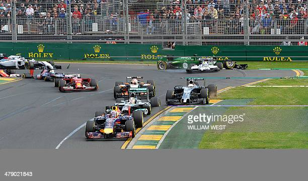Williams driver Felipe Massa of Spain is bumped from behind by the car of CaterhamRenault driver Kamui Kobayashi of Japan during an accident at the...
