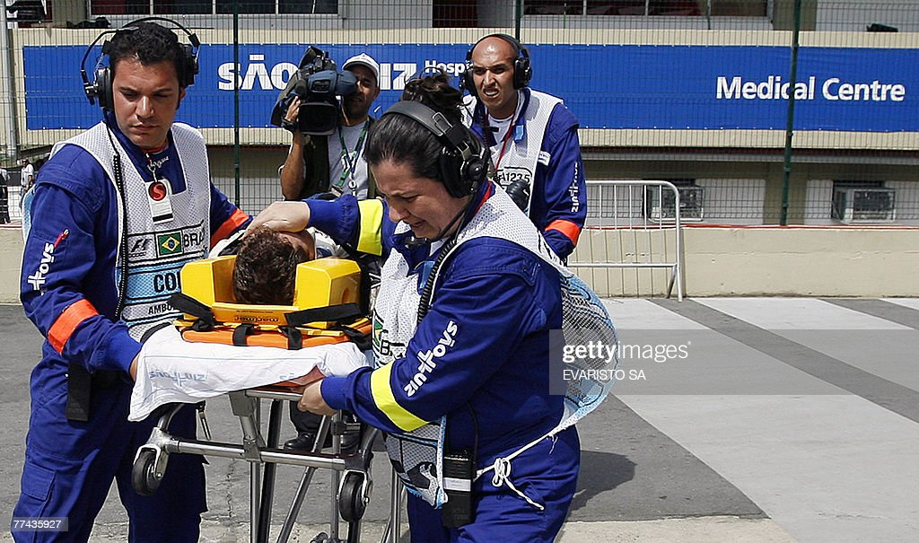 A Williams' engineer is carried out by paramedics after being knocked down by Japanese Formula One driver Kazuki Nakajima in a pit stop during Brazil's F-1 GP, 21 October 2007, at the Interlagos racetrack in Sao Paulo, Brazil. Finnish Kimi Raikkonen won both the World Championship and the race.