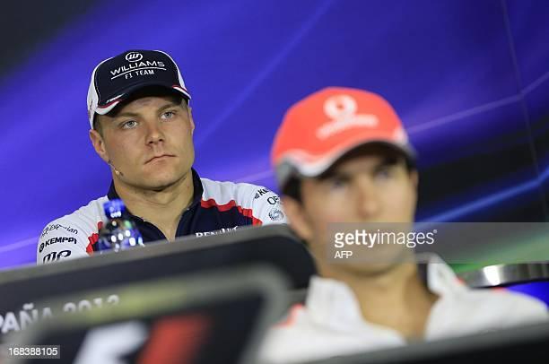 Williams' Finnish driver Valtteri Bottas and McLaren Mercedes' Mexican driver Sergio Perez sit during a press conference at the Circuit de Catalunya...