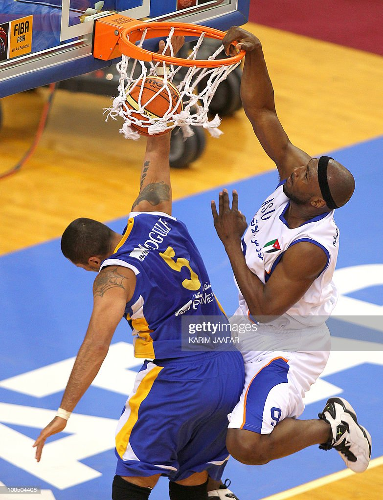 Williams James of Jordan's ASU club scores after being challenged by Hussein Tawbe of Lebanon's Al-Riyadi (L) during their 21st FIBA Asia Champions Cup basketball match at Al-Gharafa Indoor Stadium in Doha on May 25, 2010.