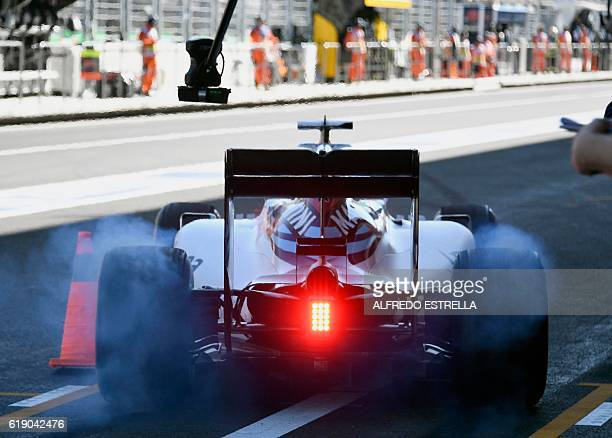 Williams Martini Racing Finnish driver Valtteri Bottas gets ready to leave the pits area during the Formula One Mexico Grand Prix practice session at...