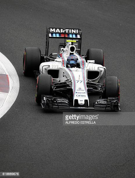 Williams Martini Racing Finnish driver Valtteri Bottas powers his car during the Formula One Mexico Grand Prix practice session at the Hermanos...
