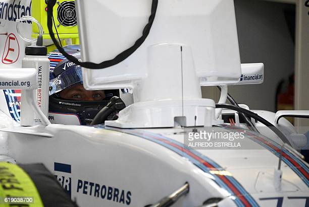 Williams Martini Racing Finnish driver Valtteri Bottas remains at the pits area during the Formula One Mexico Grand Prix practice session at the...