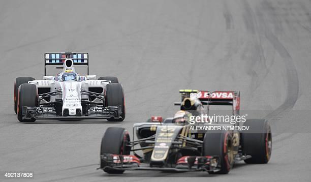Williams Martini Racing's Brazilian driver Felipe Massa and Lotus F1 Team's Venezuelan driver Pastor Maldonado drive during the qualifying session of...