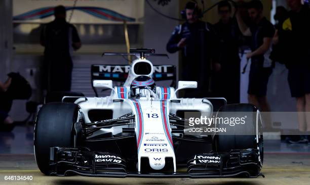 Williams Martini Racing's Canadian drive Lance Stroll leaves the garage at the Circuit de Catalunya on February 28 2017 in Montmelo on the outskirts...