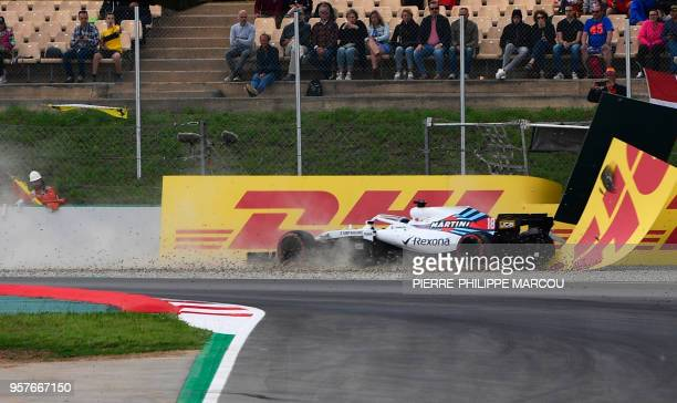 Williams Martini Racing's Canadian driver Lance Stroll crashes during the qualifying session at the Circuit de Catalunya in Montmelo in the outskirts...