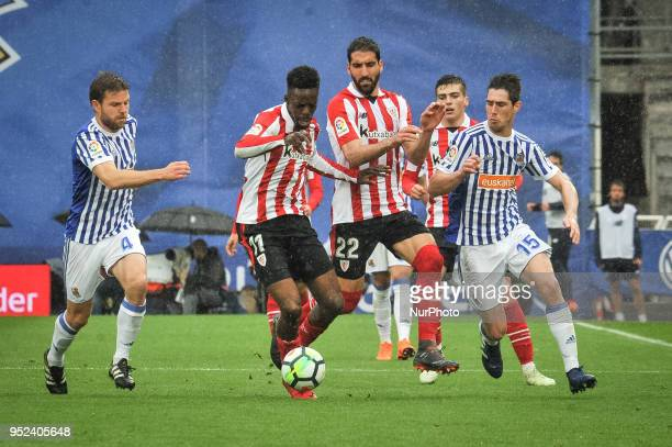 Williams of Athletic Club duels for the ball with Illarramendi and Aritz Elustondo of Real Sociedad during the Spanish league football match between...