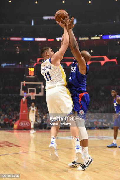 J Williams of the LA Clippers blocks the shot of Klay Thompson of the Golden State Warriors on January 6 2018 at STAPLES Center in Los Angeles...