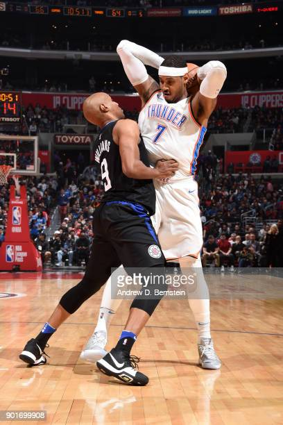 J Williams of the LA Clippers defends against Carmelo Anthony of the Oklahoma City Thunder during the game between the two teams on January 4 2018 at...