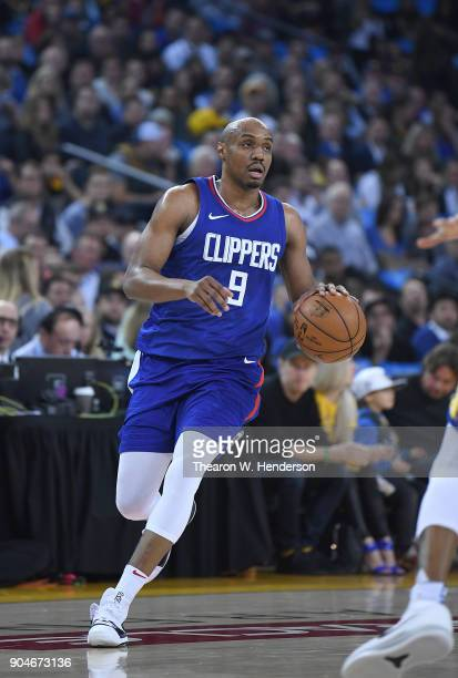J Williams of the LA Clippers dribbles the ball against the Golden State Warriors during the first half of their NBA Basketball game at ORACLE Arena...