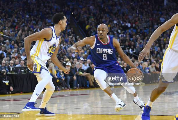 J Williams of the LA Clippers drives towards the basket on Shaun Livingston of the Golden State Warriors during the first half of their NBA...