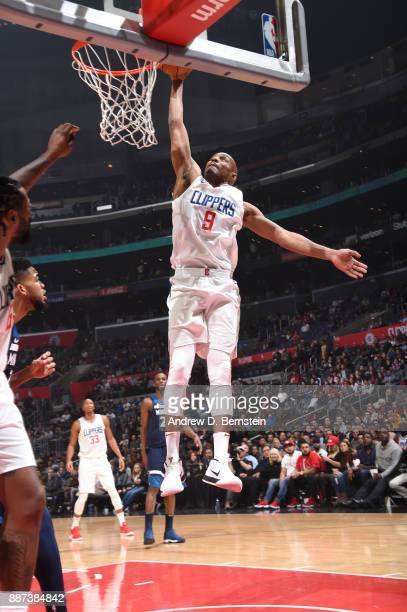J Williams of the LA Clippers goes up for a dunk against the Minnesota Timberwolves on December 6 2017 at STAPLES Center in Los Angeles California...