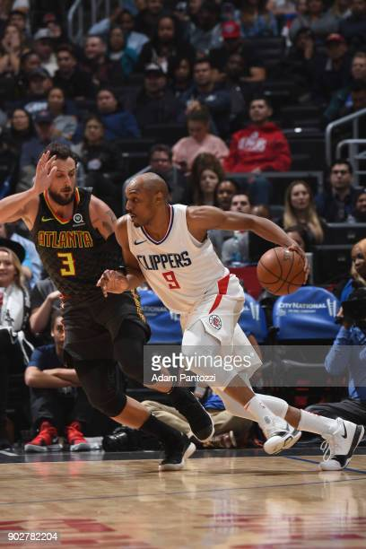 J Williams of the LA Clippers handles the ball against Marco Belinelli of the Atlanta Hawks on January 8 2018 at STAPLES Center in Los Angeles...