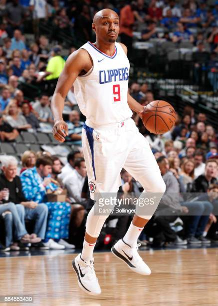 J Williams of the LA Clippers handles the ball against the Dallas Mavericks on December 2 2017 at the American Airlines Center in Dallas Texas NOTE...