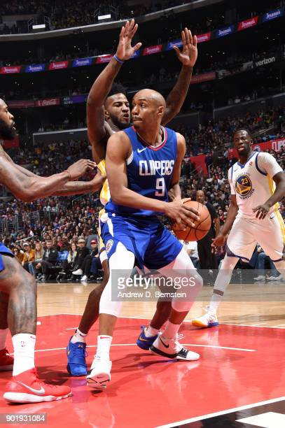 J Williams of the LA Clippers handles the ball against the Golden State Warriors on January 6 2018 at STAPLES Center in Los Angeles California NOTE...