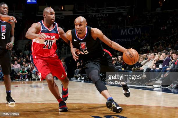 J Williams of the LA Clippers handles the ball during the game against the Washington Wizards on December 15 2017 at Capital One Arena in Washington...