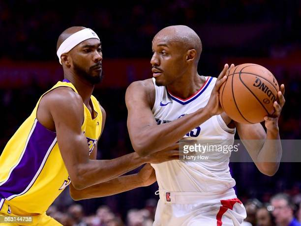 J Williams of the LA Clippers hangs on to the ball in front of Corey Brewer of the Los Angeles Lakers during a 111104 Laker win at Staples Center on...