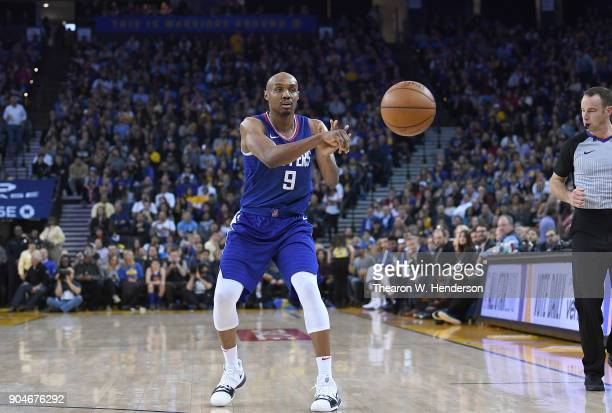 J Williams of the LA Clippers passes the ball against the Golden State Warriors during the first half of their NBA Basketball game at ORACLE Arena on...