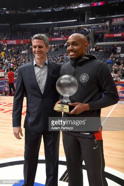 J Williams of the LA Clippers receives the 201718 NBA GLeague Jason Collier Sportsmanship Award before the game against the Los Angeles Lakers on...