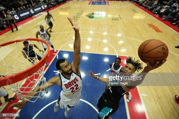 J Williams of the Greensboro Swarm drives to the basket during the game against the Grand Rapids Drive at the DeltaPlex Arena on March 23 2018 in...