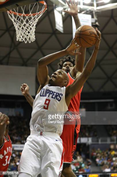J Williams of the Los Angeles Clippers shoots as he is guarded by Lucas Nogueira of the Toronto Raptors during the fourth quarter at the Stan Sheriff...