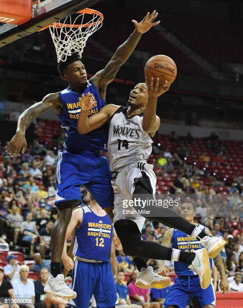 J Williams of the Minnesota Timberwolves drives to the basket against Jordan Bell of the Golden State Warriors during the 2017 Summer League at the...