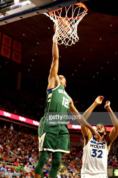 J Williams of the Minnesota Timberwolves shoots the ball against the Milwaukee Bucks during a preseason game on October 7 2018 at the Hilton Coliseum...