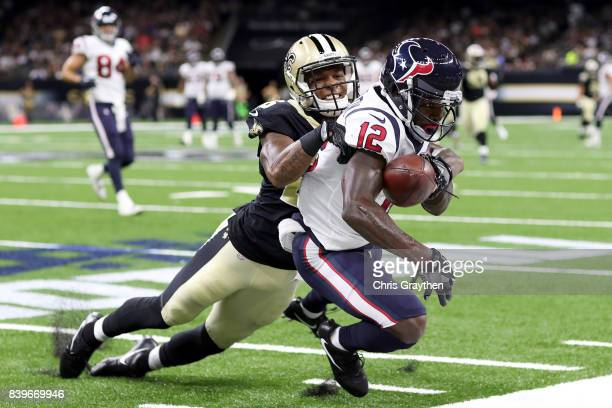 J Williams of the New Orleans Saints breaks up a pass intended for Bruce Ellington of the Houston Texans at MercedesBenz Superdome on August 26 2017...