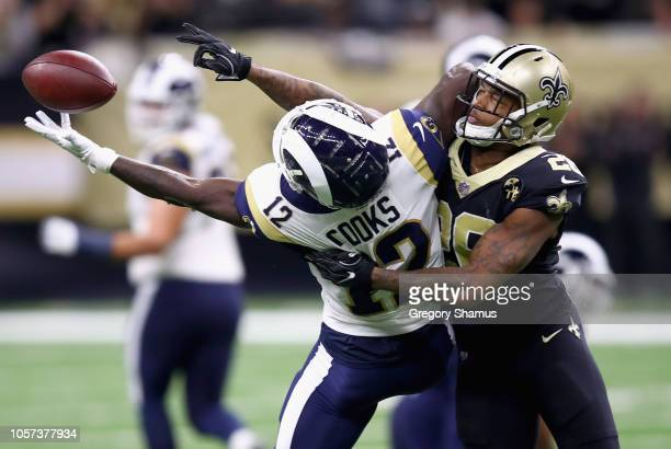 J Williams of the New Orleans Saints breaks up the pass meant for Brandin Cooks of the Los Angeles Rams during the fourth quarter of the game at...