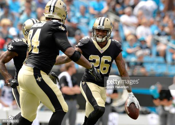J Williams of the New Orleans Saints celebrates with teammates after intercepting a pass from Cam Newton of the Carolina Panthers during their game...