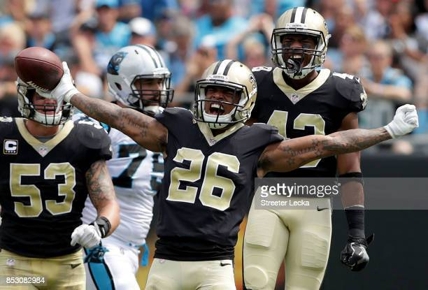 J Williams of the New Orleans Saints reacts after making an interception against the Carolina Panthers during their game at Bank of America Stadium...
