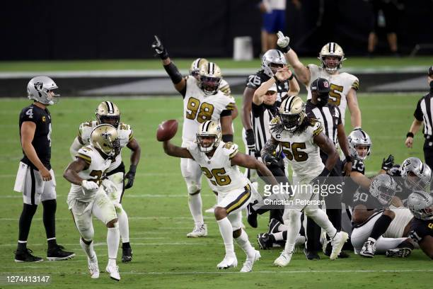 J Williams of the New Orleans Saints recovers a fumble during the fourth quarter against the Las Vegas Raiders at Allegiant Stadium on September 21...