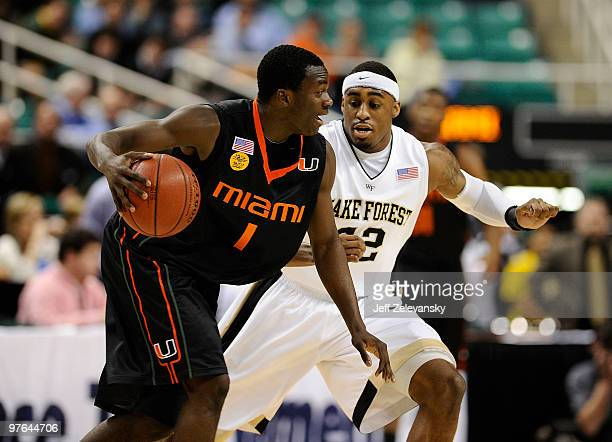 D Williams of the Wake Forest Demon Deacons guards Durand Scott of the University of Miami Hurricanes in their first round game in the 2010 ACC Men's...