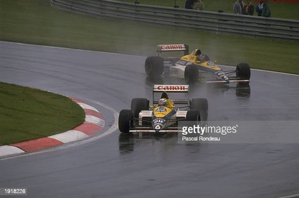 Williams Renault drivers Thierry Boutsen of Belgium and Riccardo Patrese of Italy in action on the wet surface during the Canadian Grand Prix at the...