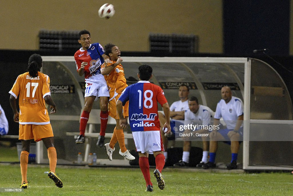 Williams Reyes(L) of FAS jumps for the ball with Jonathan Fana of Islanders during their match as part of 2010 CONCACAg Champions League at Juan Ramon Loubriel Stadium on August 25, 2010 in Baymon, Puerto Rico.