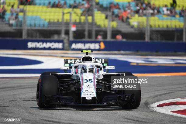 Williams' Russian driver Sergey Sirotkin drives at the Marina Bay Street Circuit during the first practice session ahead of the Singapore Formula One...