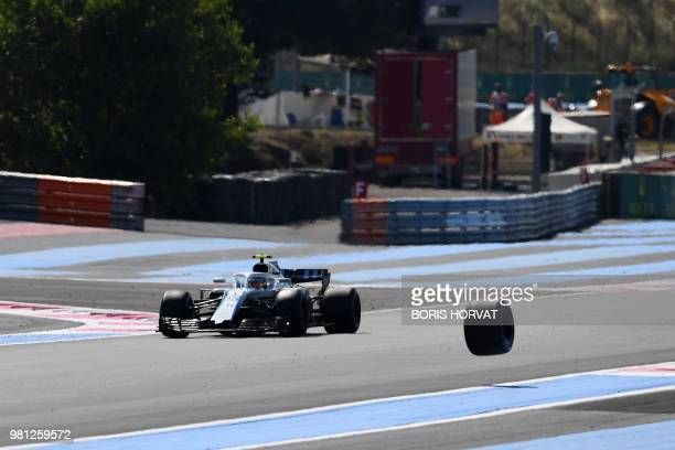 William's Russian driver Sergey Sirotkin drives during the second practice session as the tire of Force India's Mexican driver Sergio Perez's car...