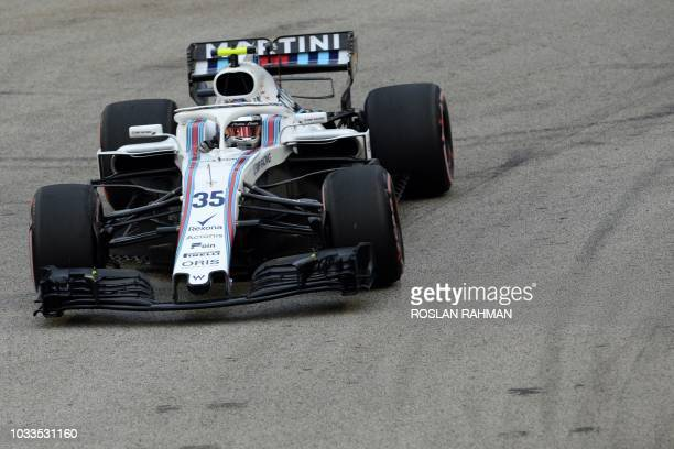 Williams' Russian driver Sergey Sirotkin drives during the third practice session ahead of the Singapore Formula One Grand Prix at the Marina Bay...