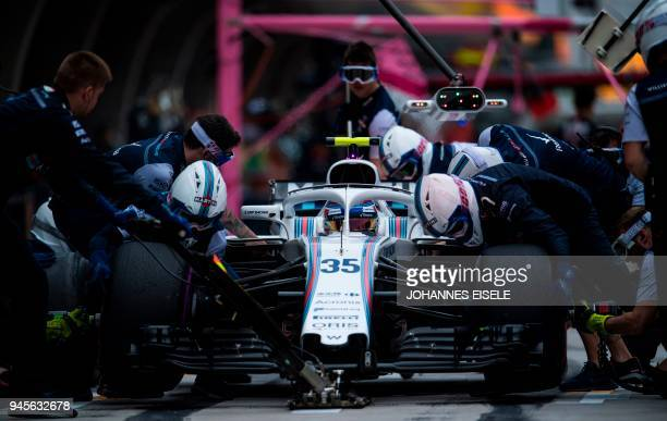 Williams' Russian driver Sergey Sirotkin gets his tyres changed during a practice session for the Formula One Chinese Grand Prix in Shanghai on April...