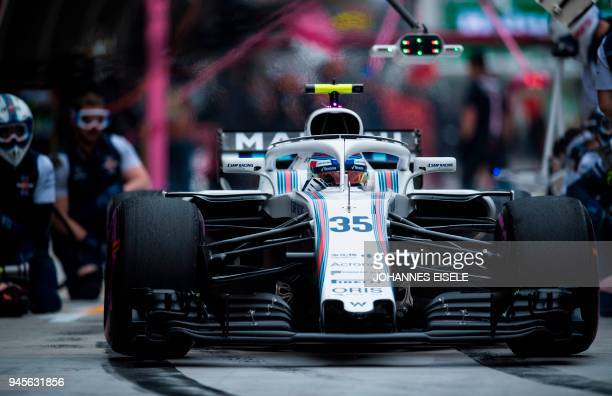 Williams' Russian driver Sergey Sirotkin steers his car out of the pits during a practice session for the Formula One Chinese Grand Prix in Shanghai...