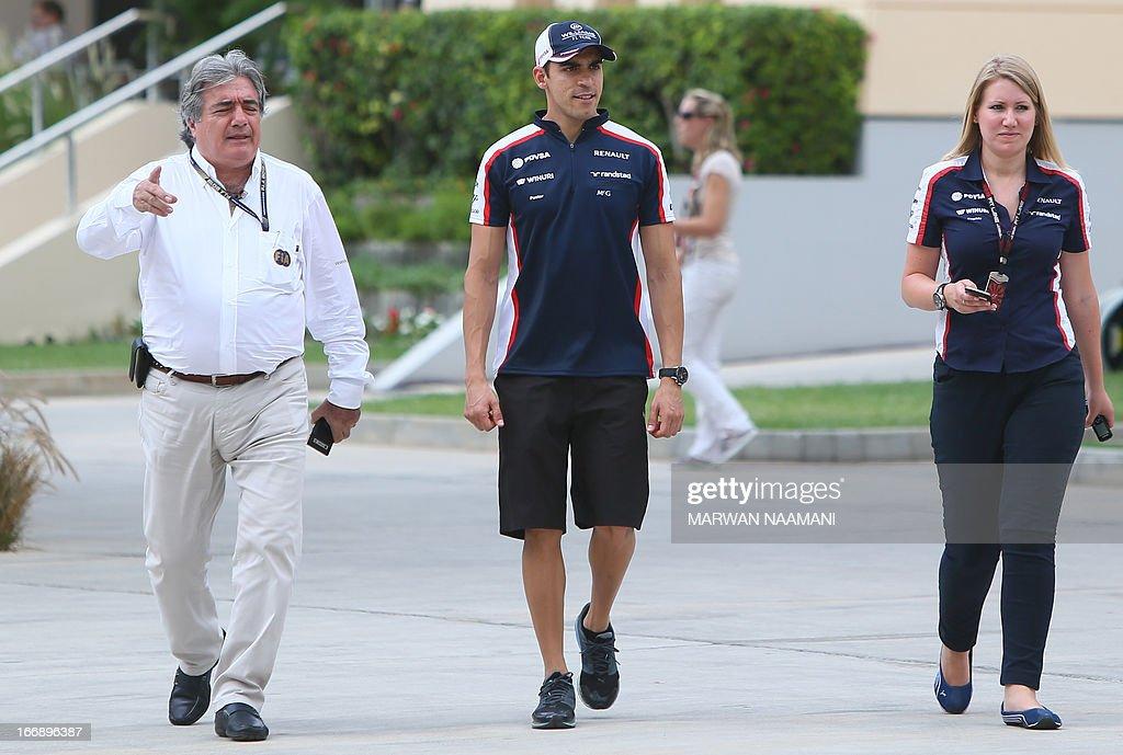 William's Venezuelan driver Pastor Maldonado (C) walks in the paddock before a press conference on April 18, 2013 at the Bahrain International Circuit in Manama ahead of the Bahrain Formula One Grand Prix.