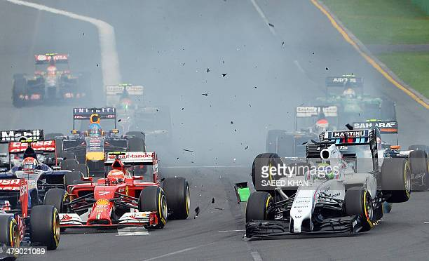 WilliamsMercedes driver Felipe Massa of Spain is bumped from behind by the car of CaterhamRenault driver Kamui Kobayashi of Japan during an accident...