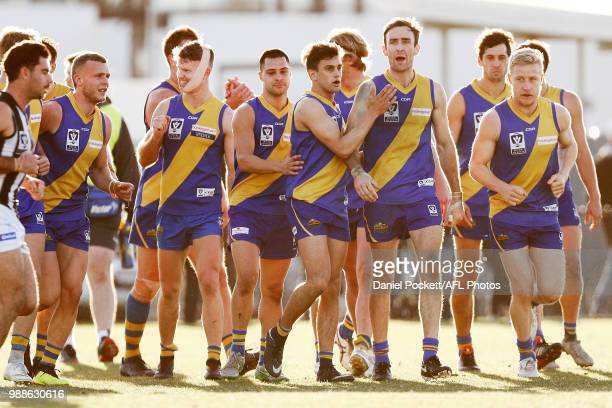 Williamstown players celebrate a goal during the round 13 VFL match between Williamstown and Collingwood at Williamstown Football Ground on July 1,...