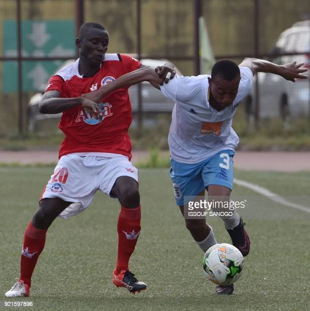 Williamsville's Roland Irie fights for the ball with Stade Malien's Oumar Kone during the CAF Champions league football match between Williamsville...
